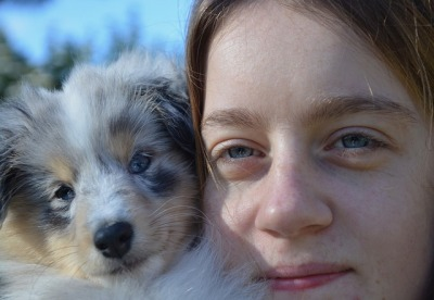 woman with aussie puppy